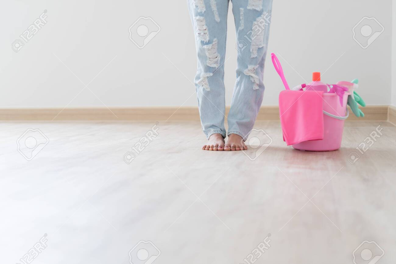 Cleaning concept. Asian woman with bucket of cleaning supplies - 115235636