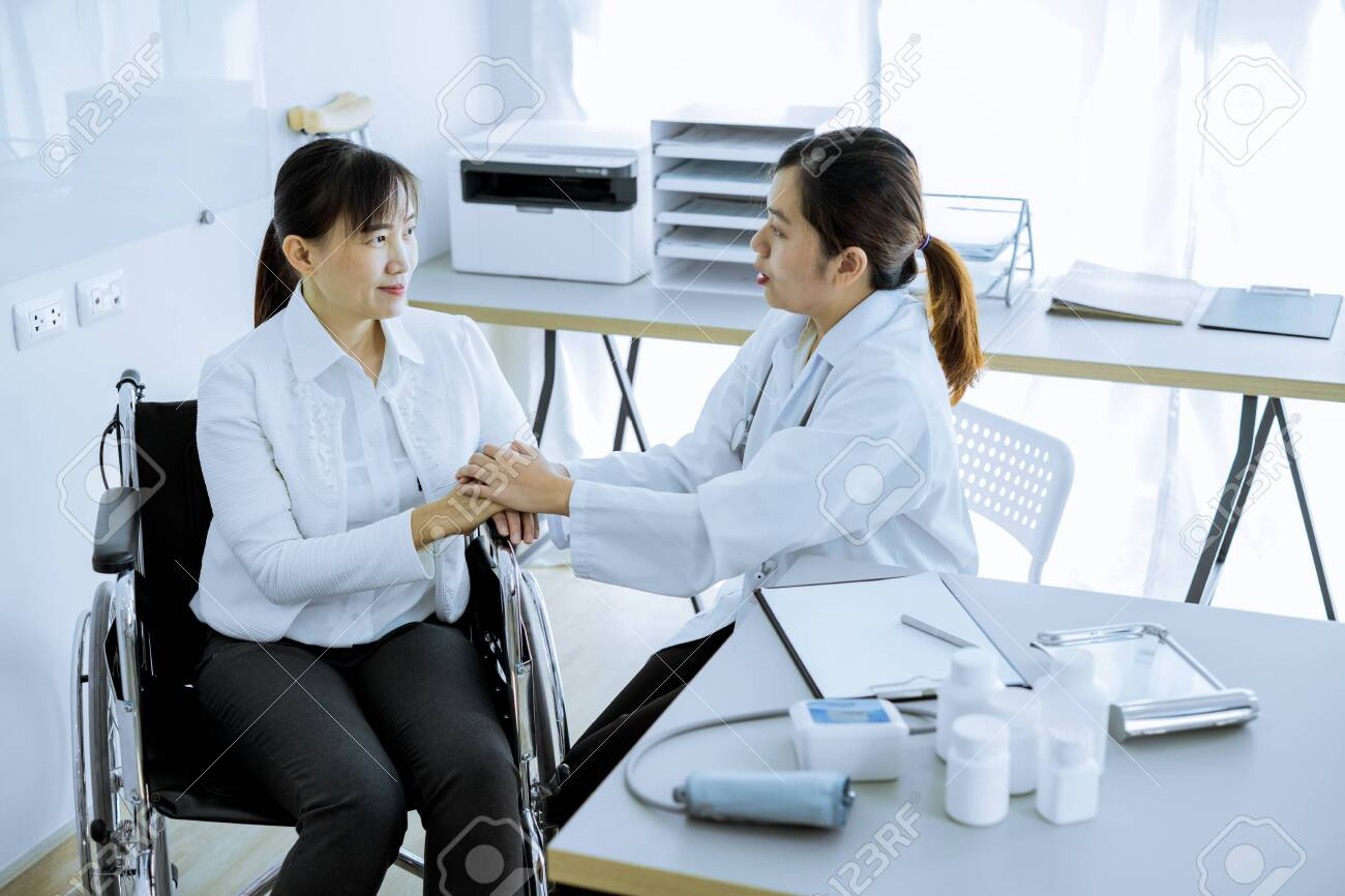 Hand of doctor reassuring her female patient - 121175364
