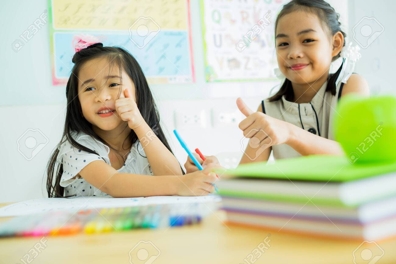 Asian cute little child girl drawing at home - 121177791