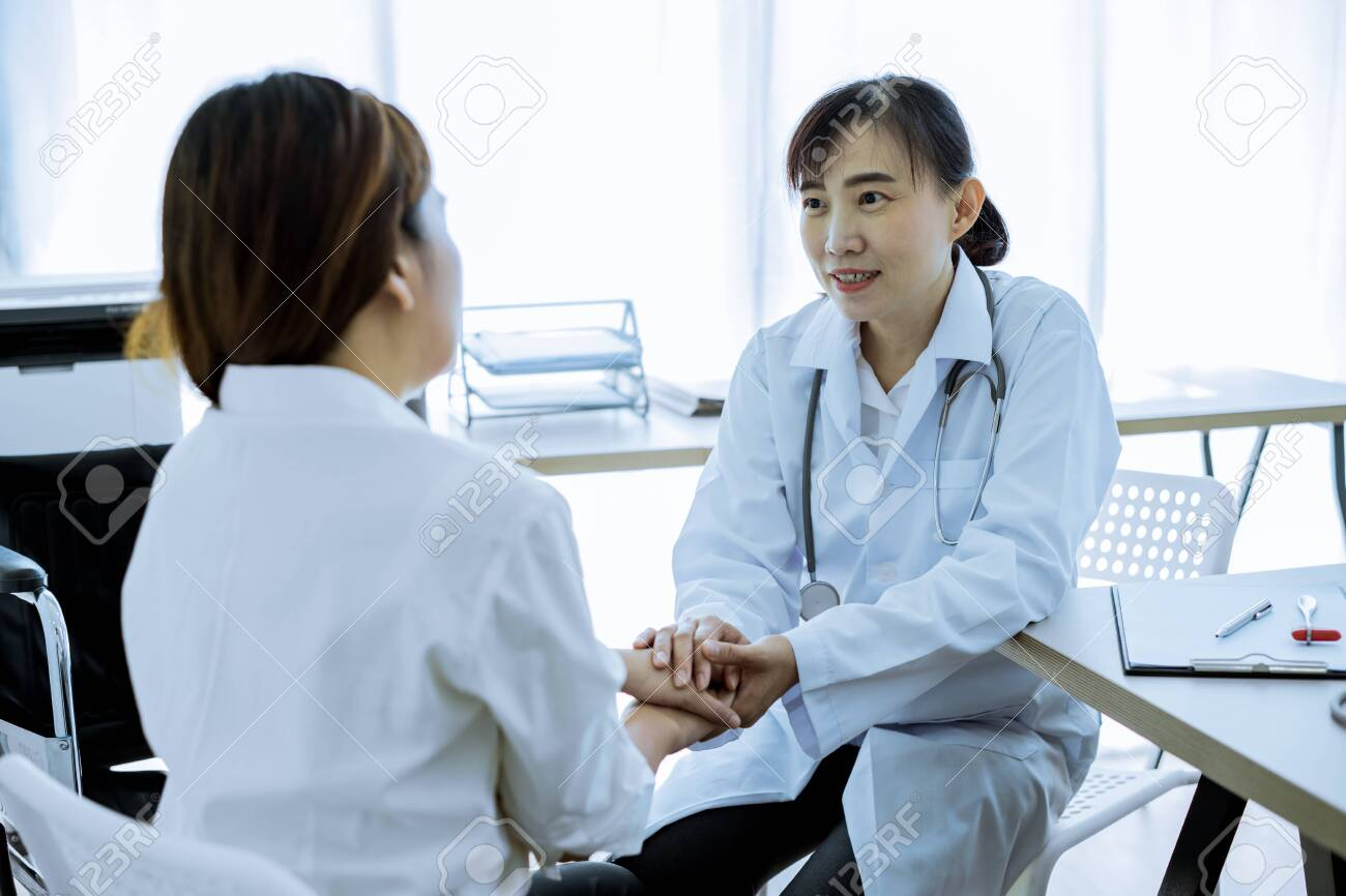 Hand of doctor reassuring her female patient - 121178384