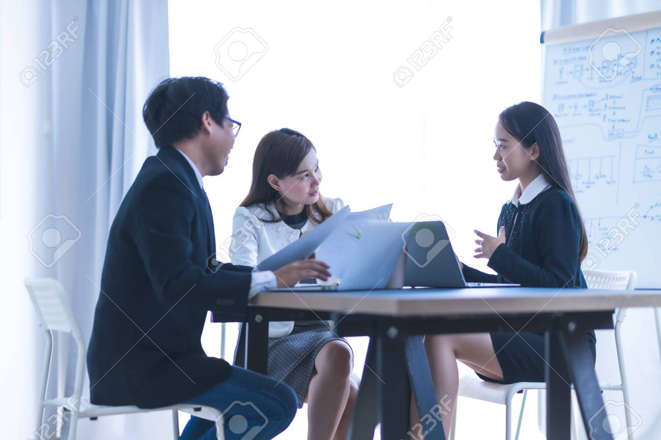 Group of business people busy discussing financial matter during meeting. - 145512892