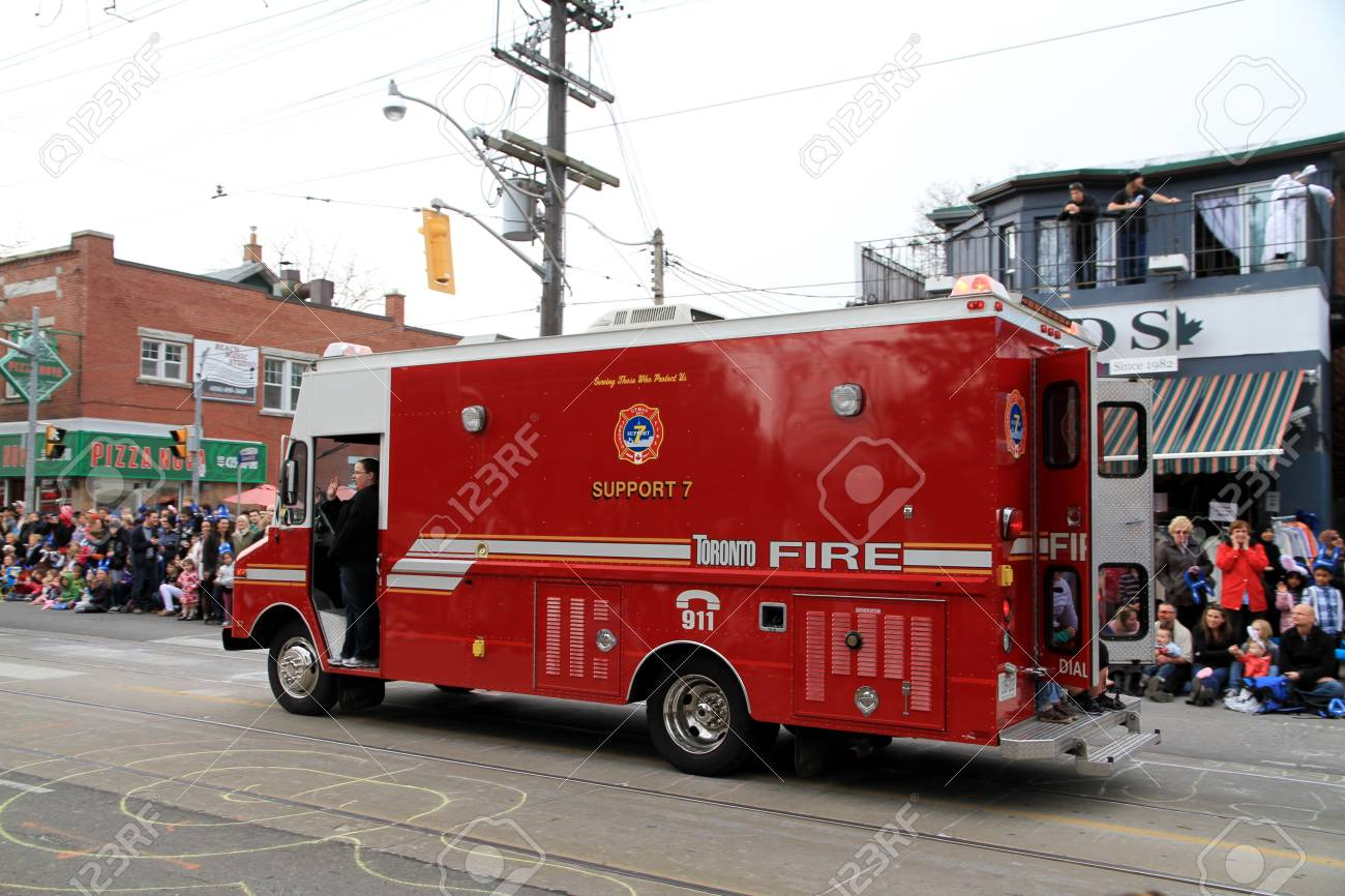 A Toronto fire fighting vehicle during a street parade Stock Photo - 13353373