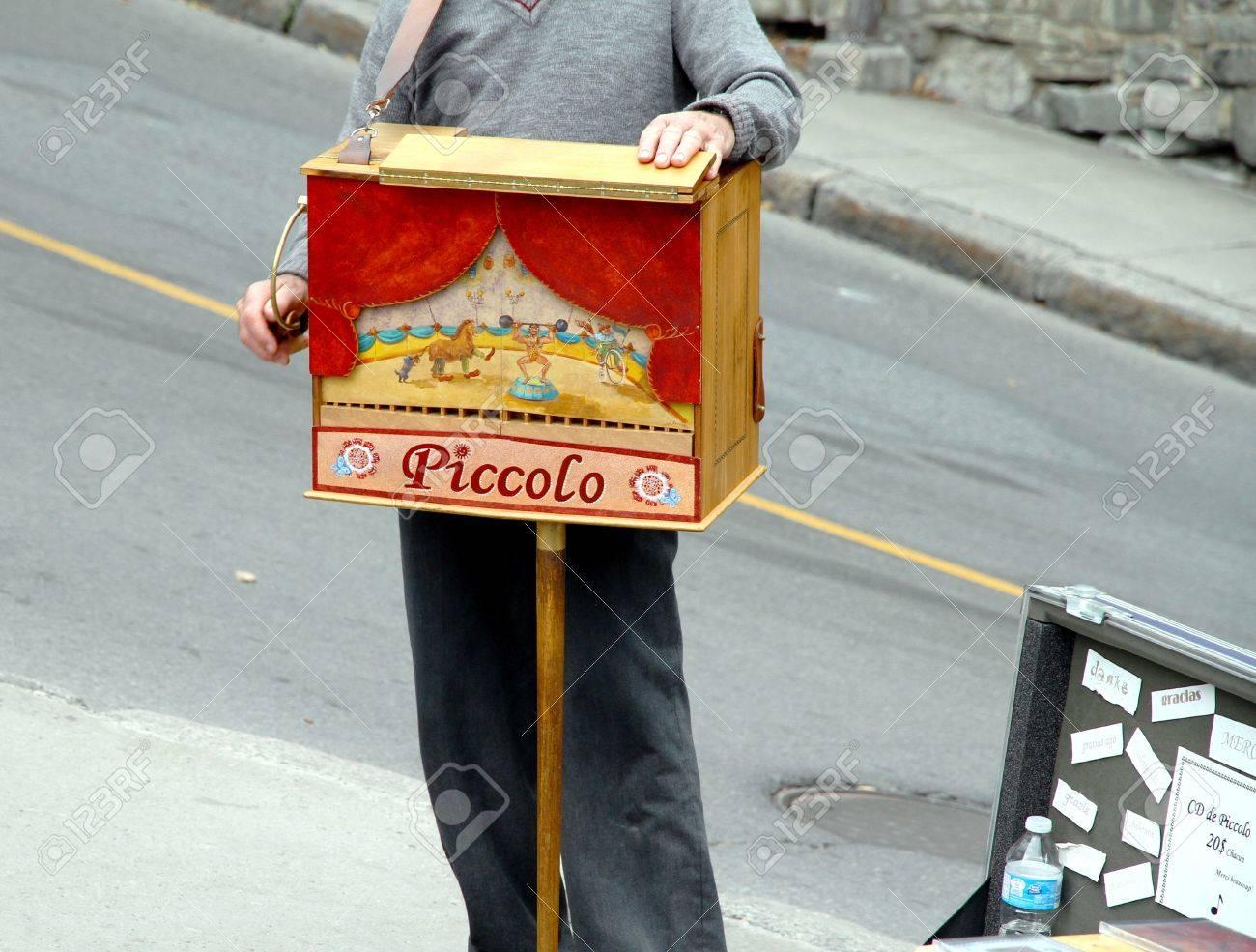 Quebec City, Canada, September 9, 2012 - A man playing a street organ Stock Photo - 15902572