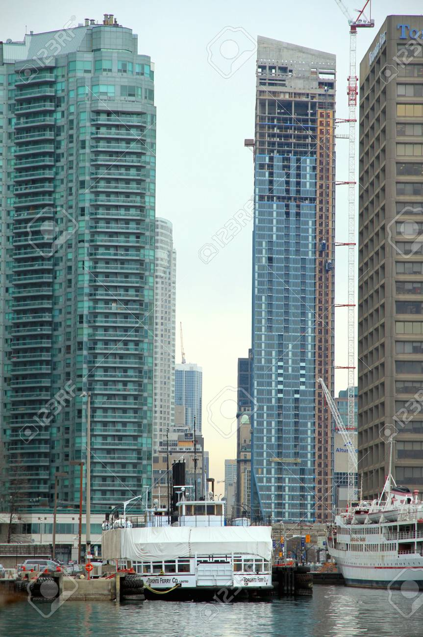 TORONTO - APRIL 9: The harbor and Downtown Toronto modern architecture on April 9, 2013 in Toronto. Downtown Toronto has prominent buildings in a variety of styles by many famous architects. Stock Photo - 20805917