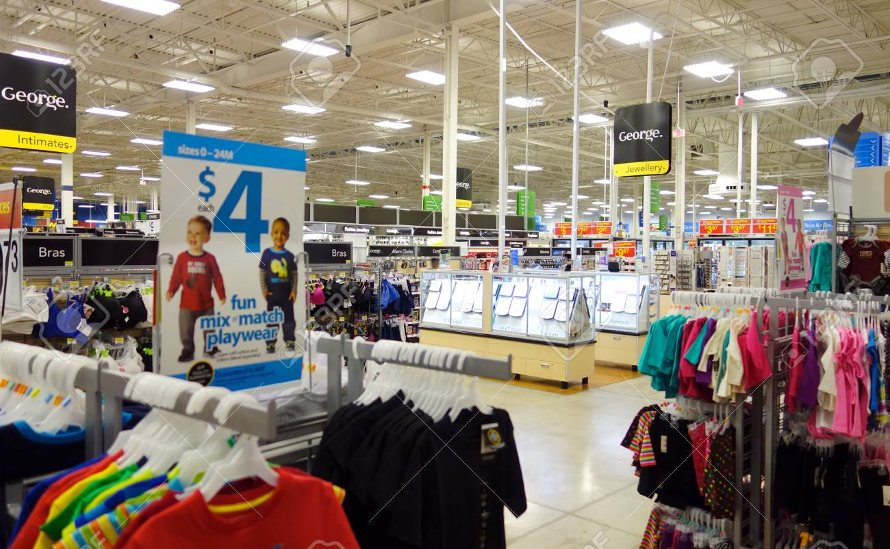 3a7c89ad028 Children clothing section in a big store Stock Photo - 27061149