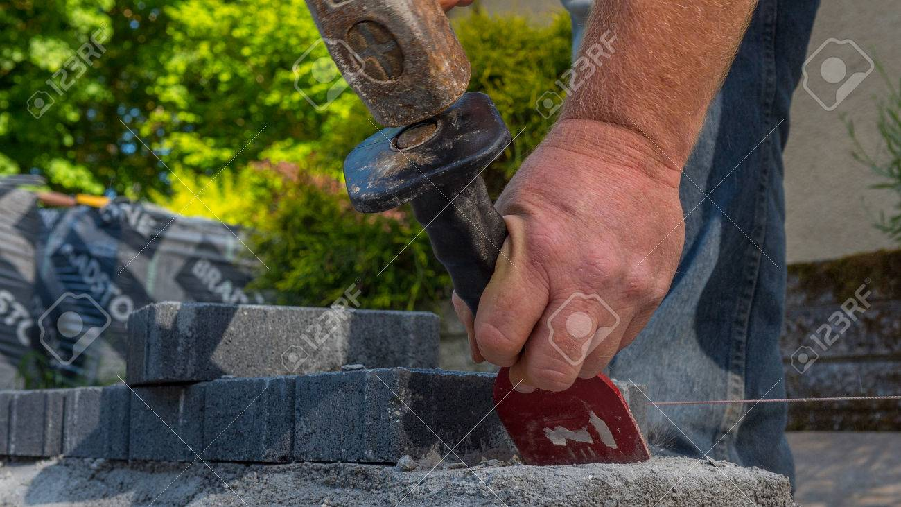 bricklayer tools man working on construction site - 80466671