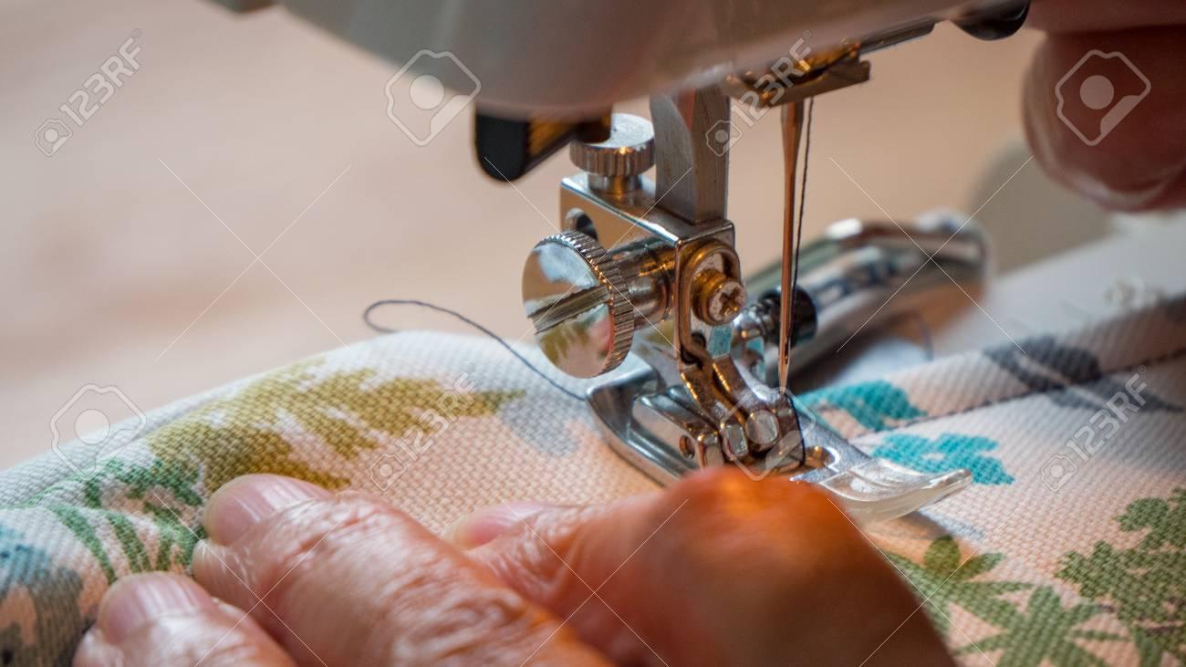 female hand using sewing machine stitching fabic - 80812809