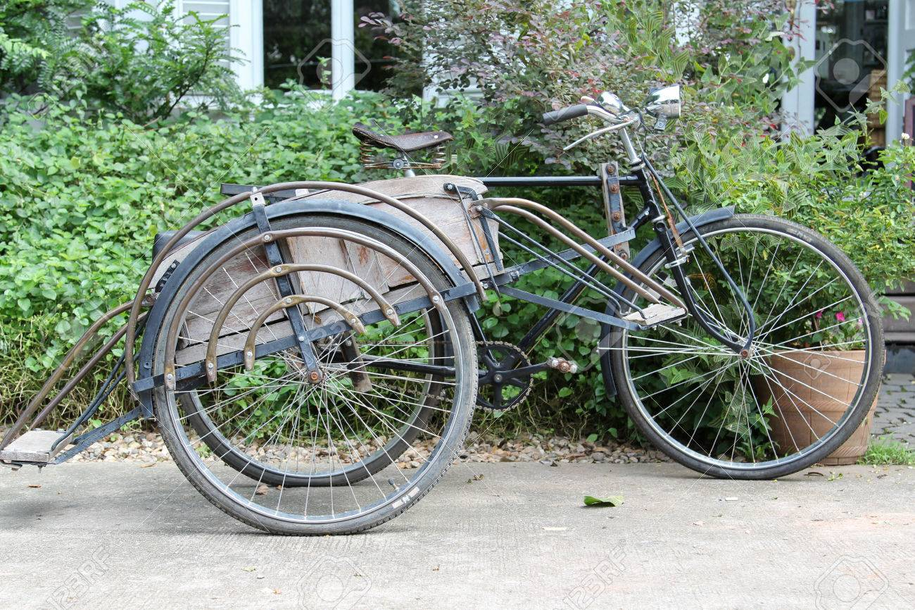 Old bicycle sidecar parking on concrete floor