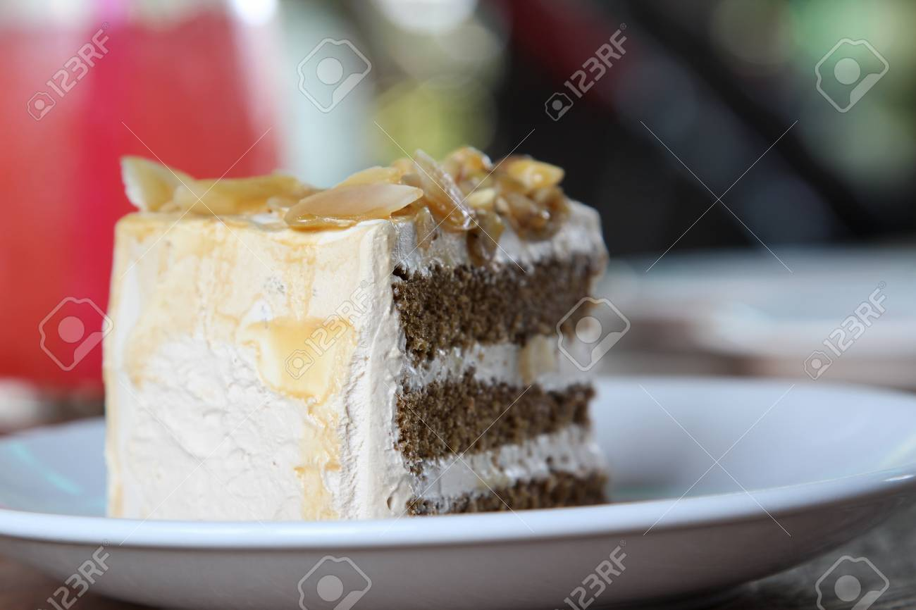 Coffee Almond Butter Cake On White Plate Stock Photo