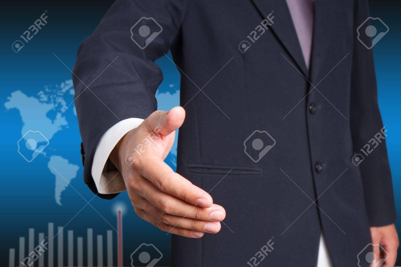 Businessman offering for handshake  on world background Stock Photo - 12660921