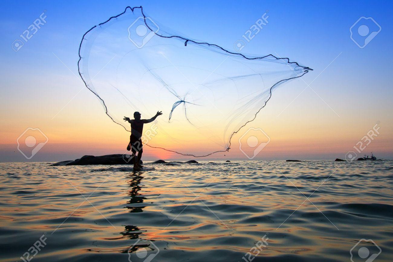 12917084-throwing-fishing-net-during-sunrise-Thailand-Stock-Photo-sea.jpg