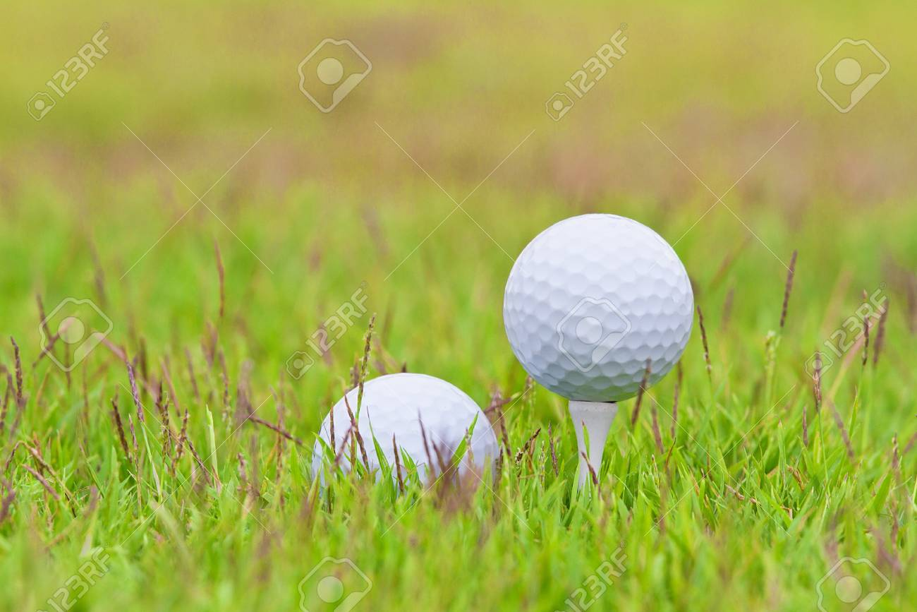 Golf ball on tee over a blurred green Stock Photo - 13231609