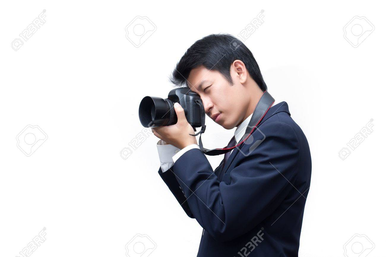 Young Asian grapher Taking With Digital Camera Stock