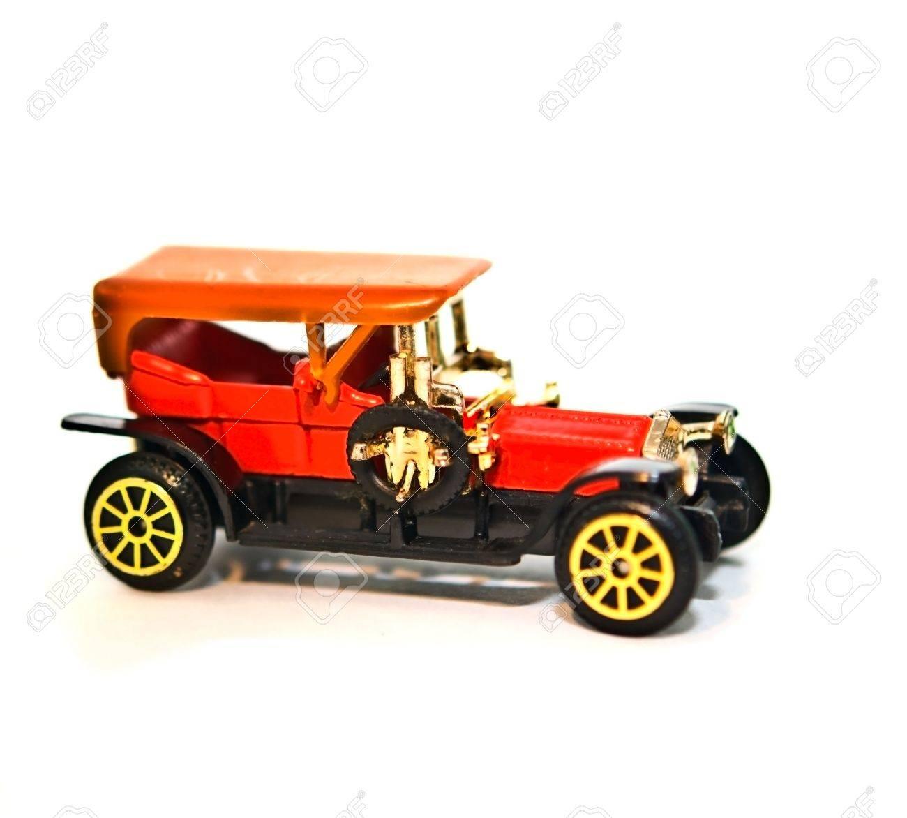 A metal replica of a 4 door antique car. Stock Photo - 7381363