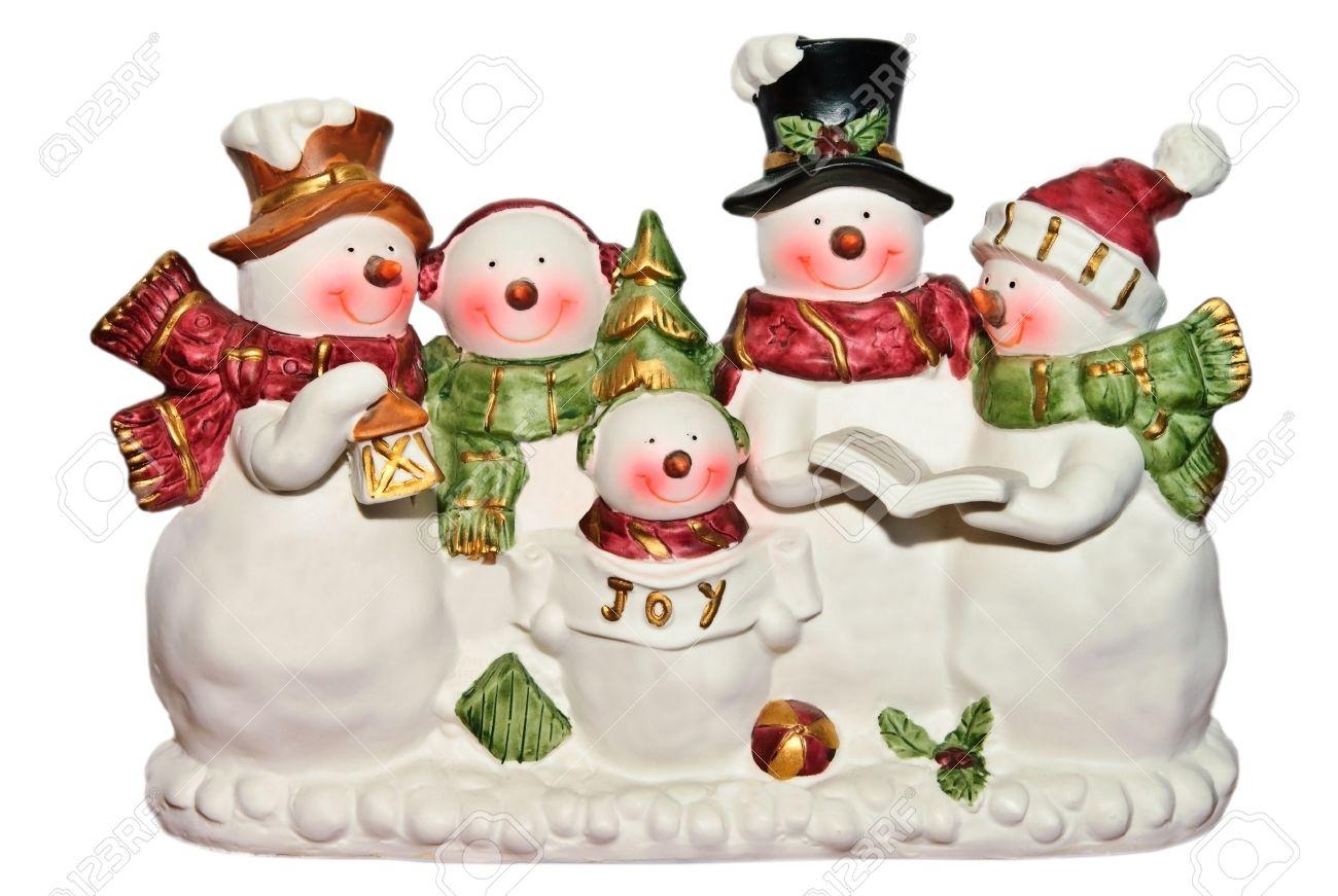 Christmas Carol Singers Figurines.Cute Happy Snowmen And Women And Children Figurines Singing Christmas