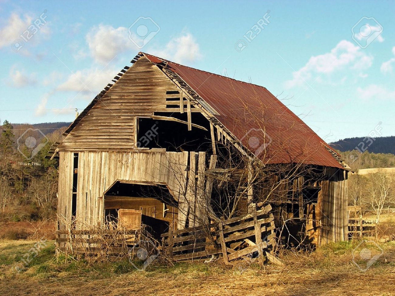 a old barn in a late winter evening stock photo picture and