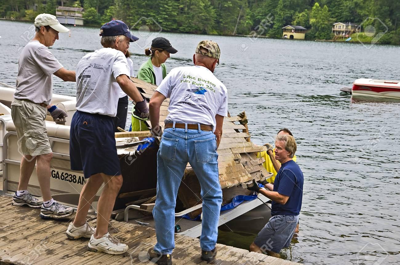 CLAYTON, GA /USA - JULY 16:  Cleaning up debris on July 16, 2011 in Lake Burton, Clayton, GA.  Stock Photo - 9915937