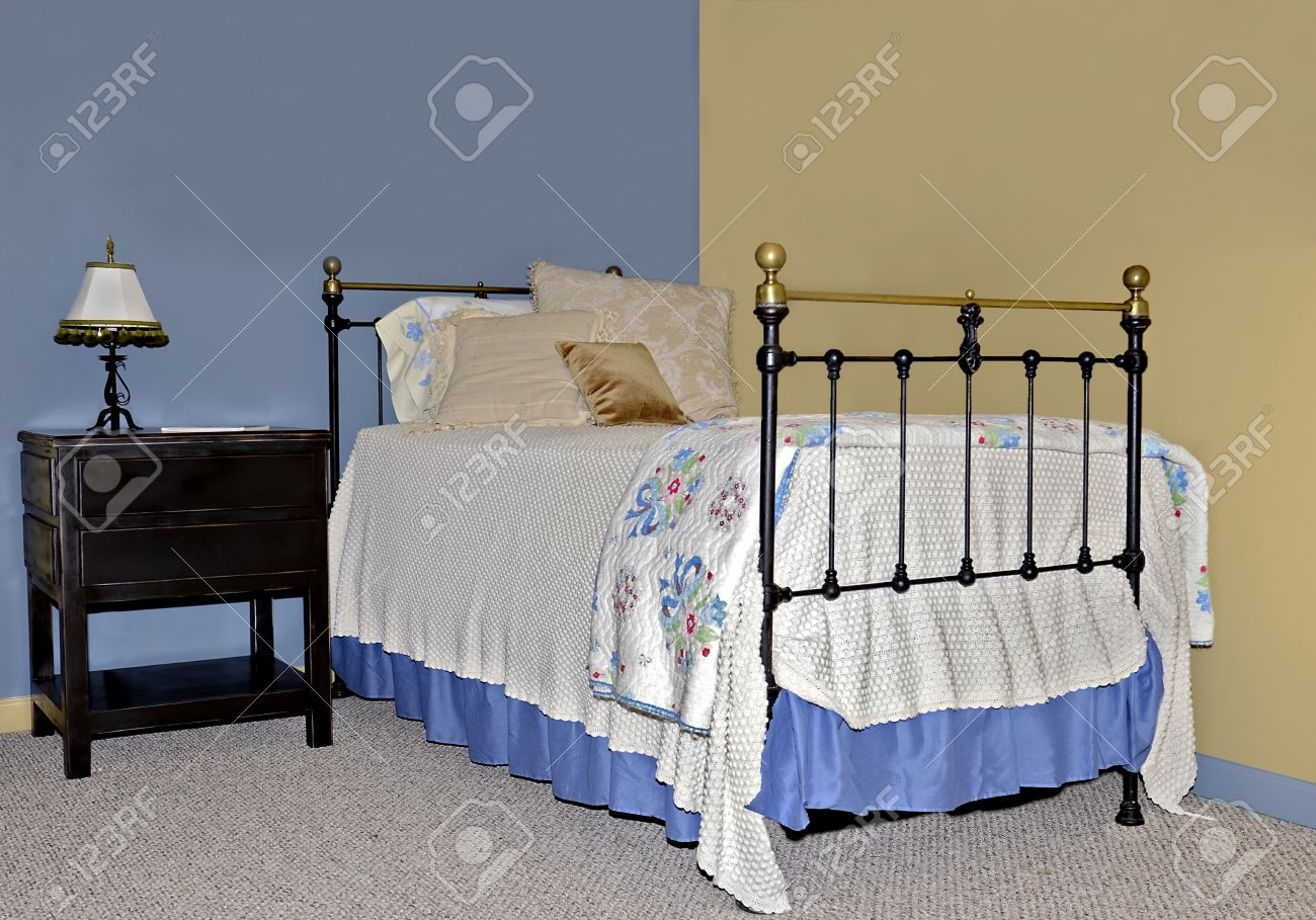 Twin Iron And Brass Bed On Walls Painted Contrasting Colors With Stock Photo Picture And Royalty Free Image Image 24263668