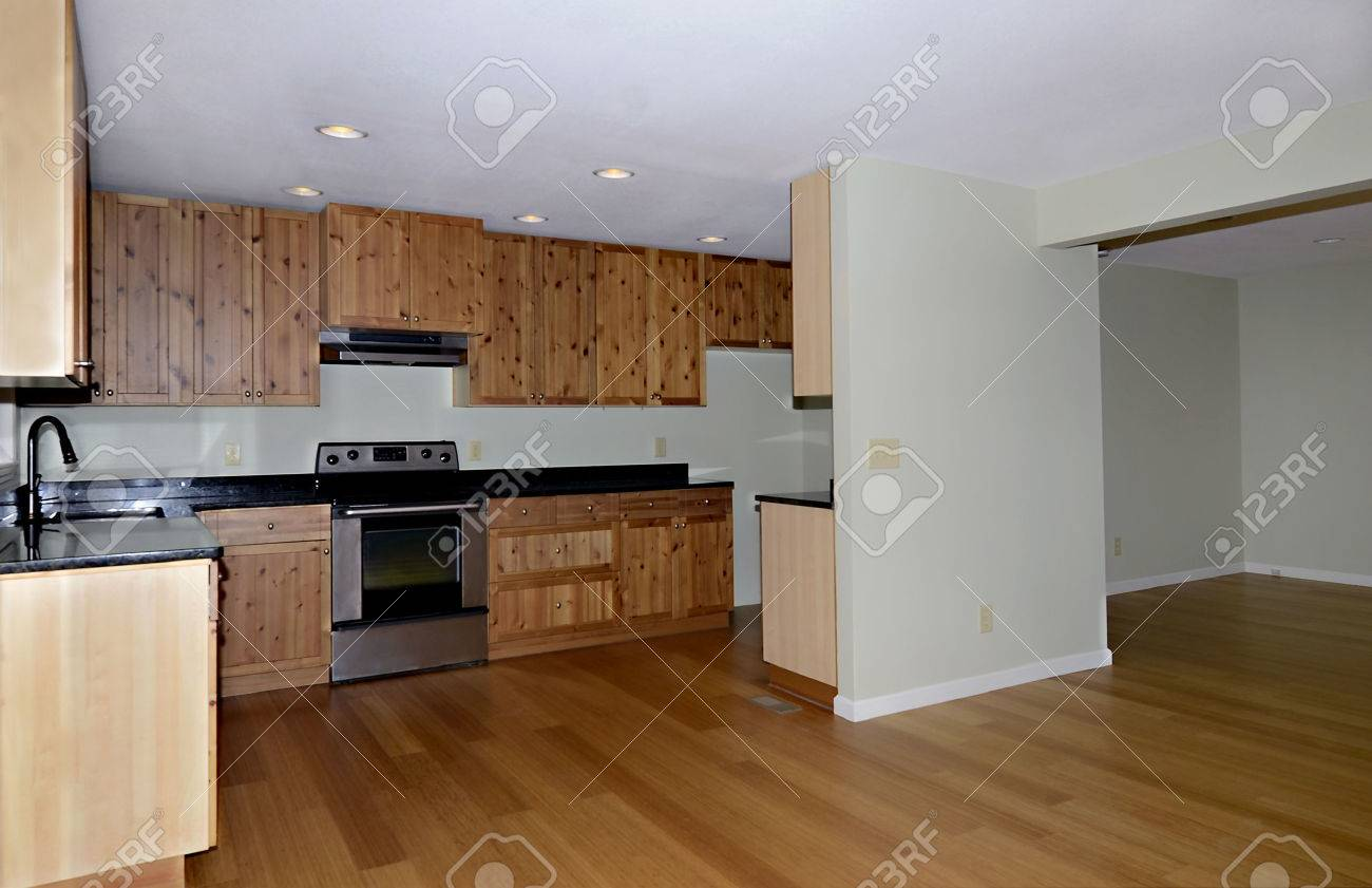 View Of A Kitchen And Dining Area With Knotty Pine Cabinets