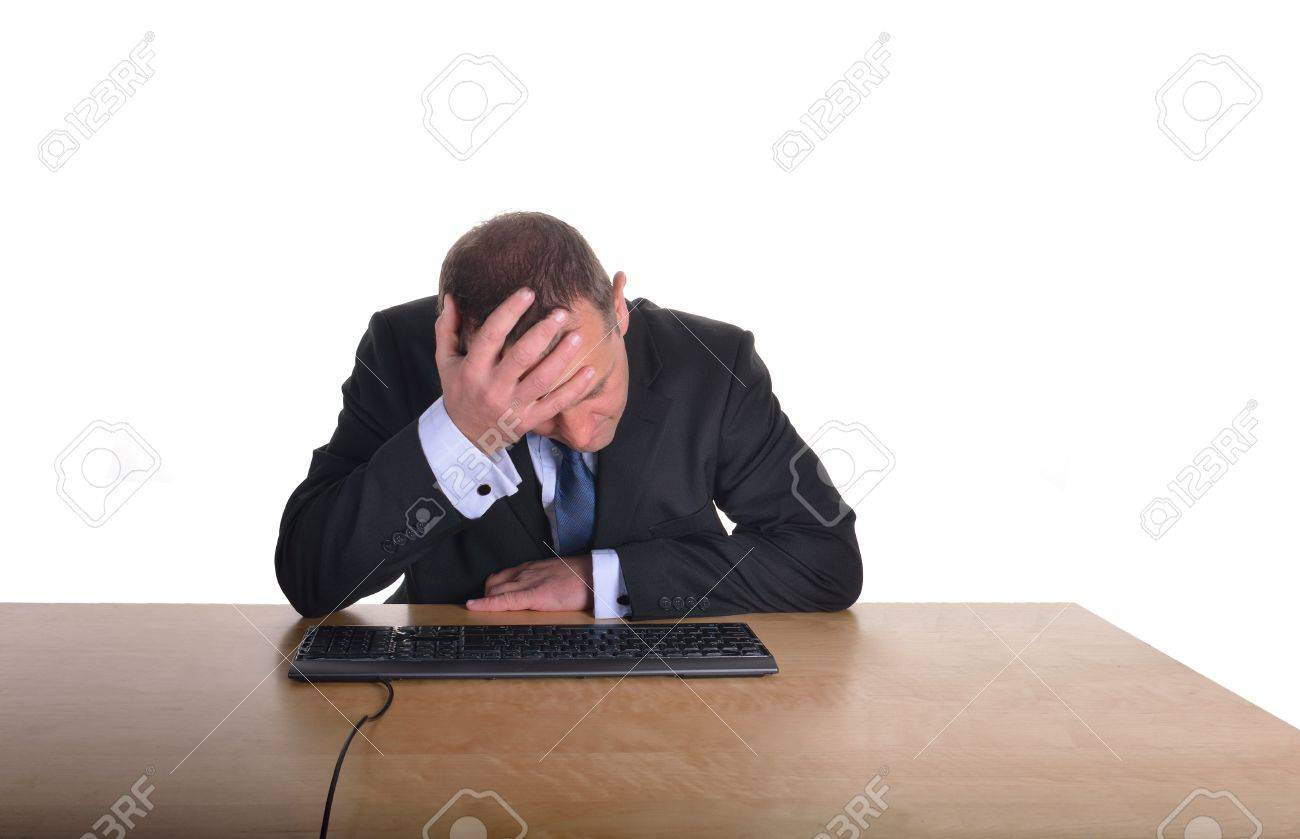 Image of a businessman in a stressed pose at a desk Stock Photo - 19650631