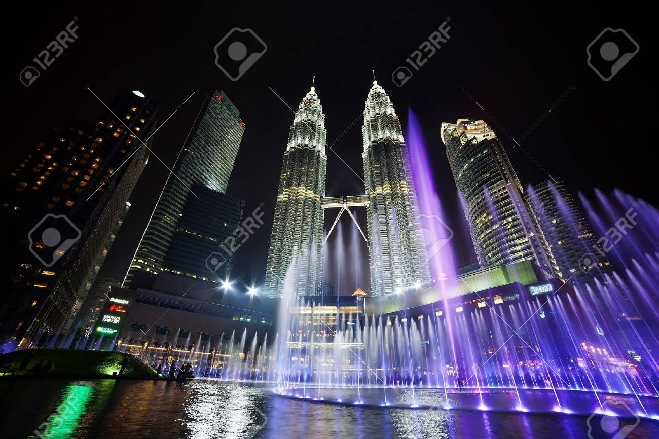 KUALA LUMPUR, MALAYSIA - APRIL 13: Fountain light show of Petronas Twin Towers on April 13, 2013 in Kuala Lumpur Malaysia. Petronas Twin Towers were the tallest buildings (452m)  in the world during 1998-2004. Stock Photo - 19169316