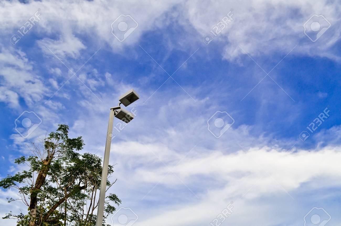 tree street lamp and blue sky Stock Photo - 10597602