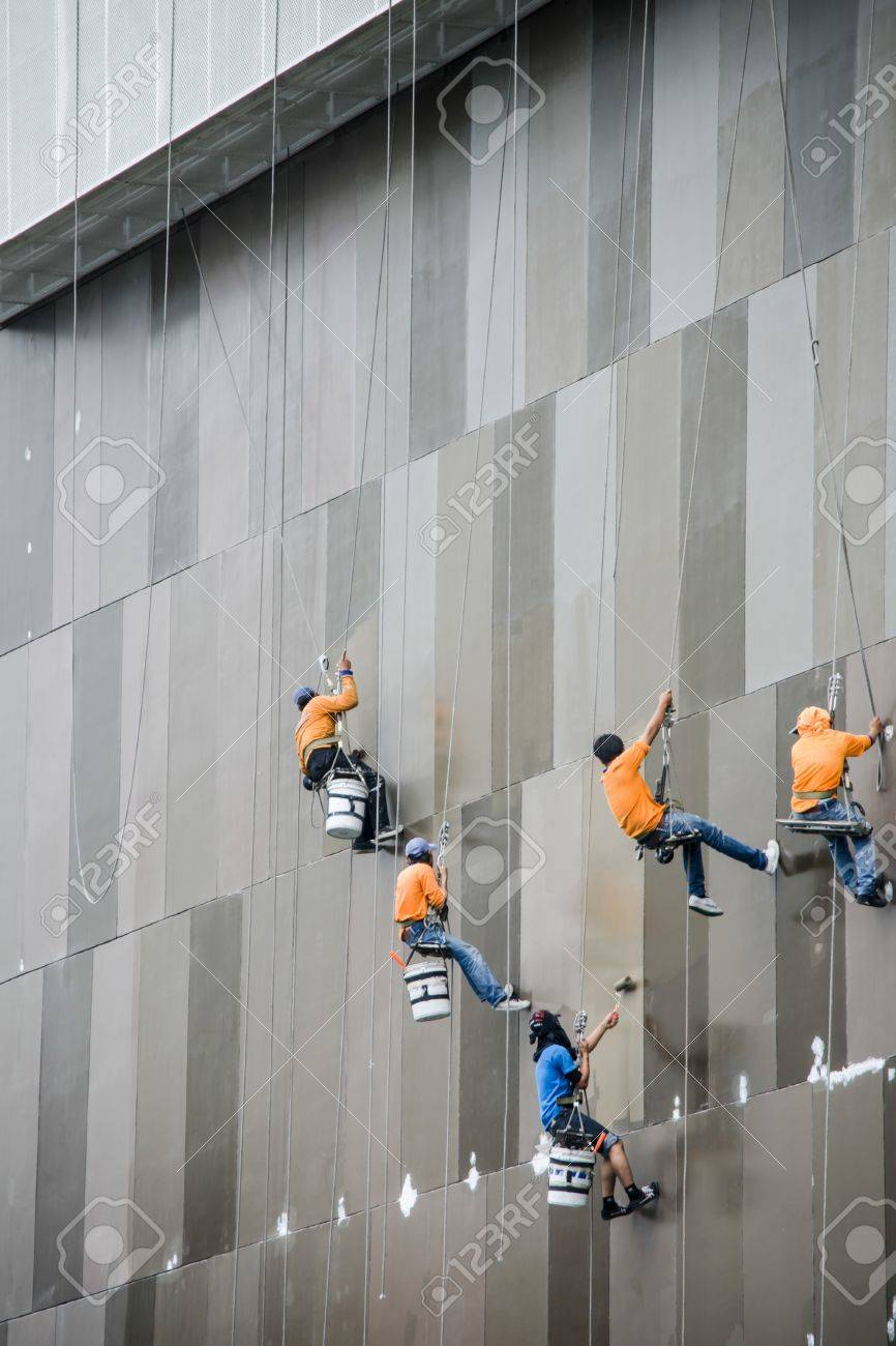 The workers clean up the building, thailand Stock Photo - 14376468