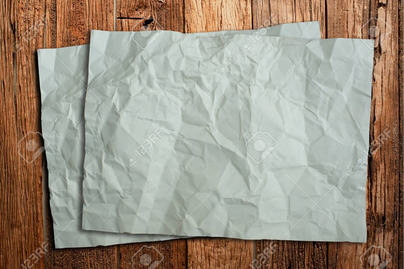 Wrinkled paper on old wood Stock Photo - 16153011