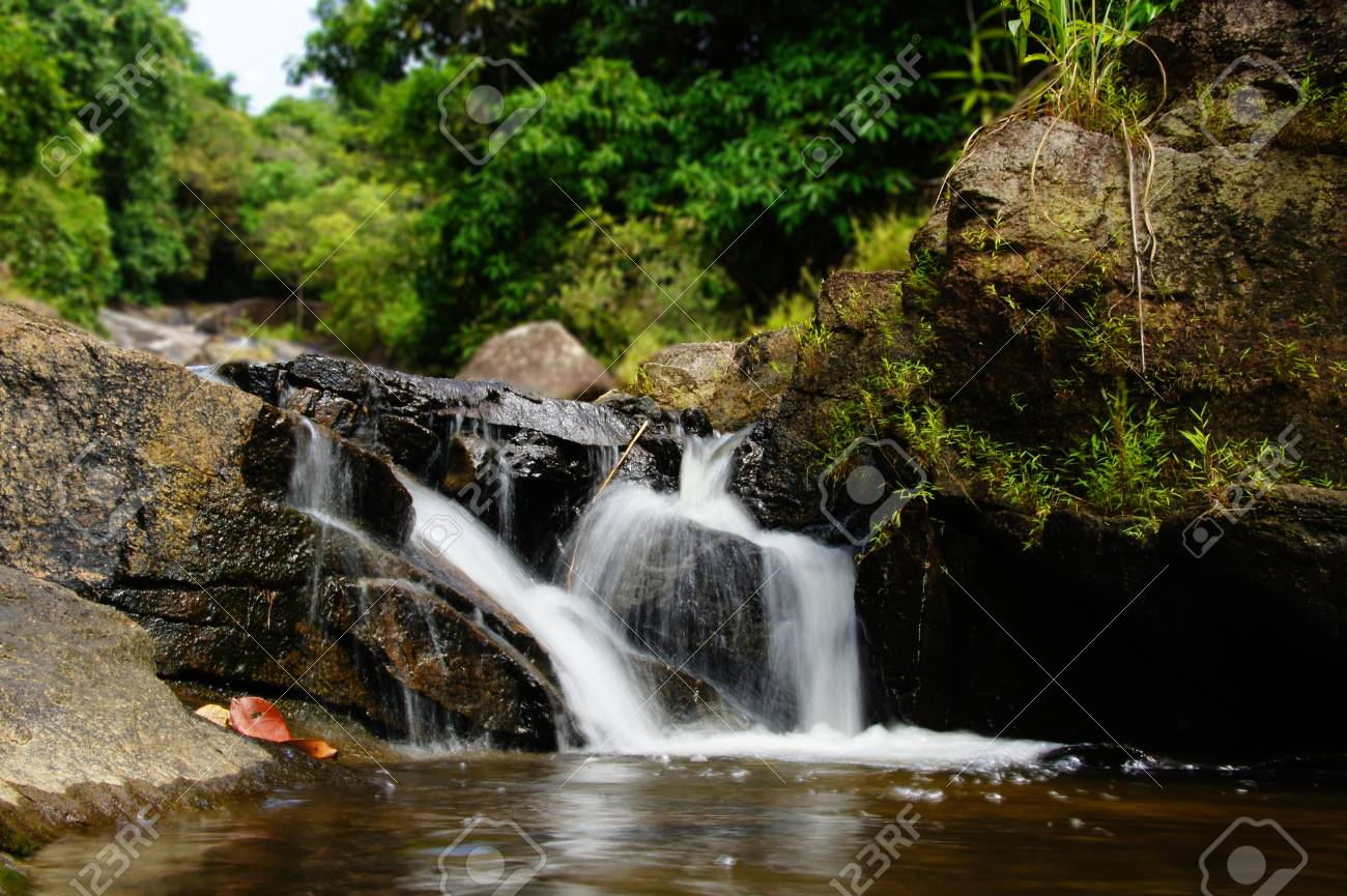 The small waterfall and rocks, thailand Stock Photo - 16563647