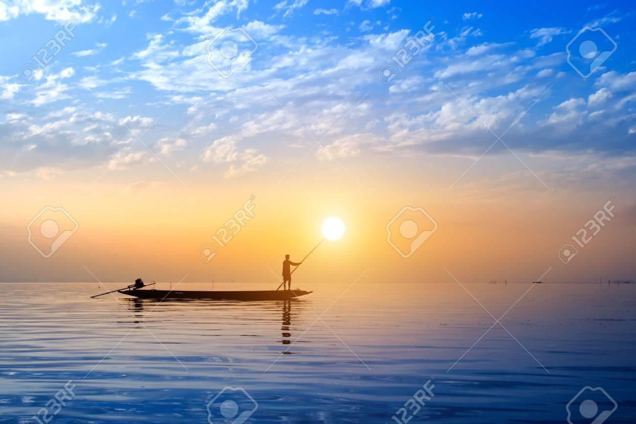 Beautiful sky and Silhouettes of Minimal fisherman at the lake, Thailand. - 43973114