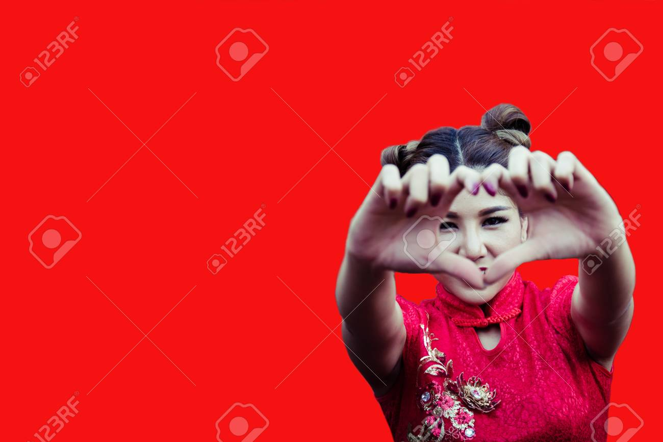 0359b26dd Caucasian woman in Chinese dress traditional cheongsam at New Year isolated  on red background. Young