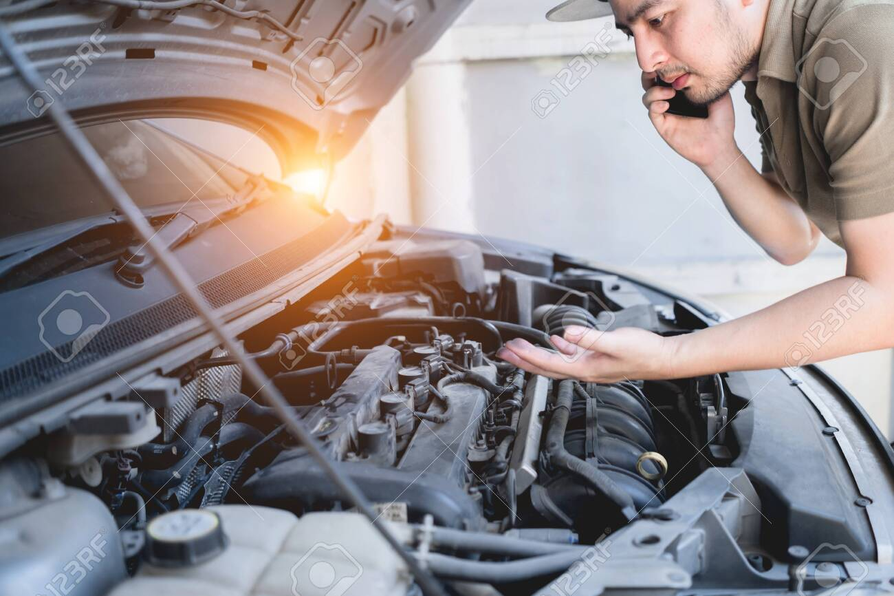 Mechanical Fixing Car At Home Repairing Service Advice By Mobile Stock Photo Picture And Royalty Free Image Image 134781307