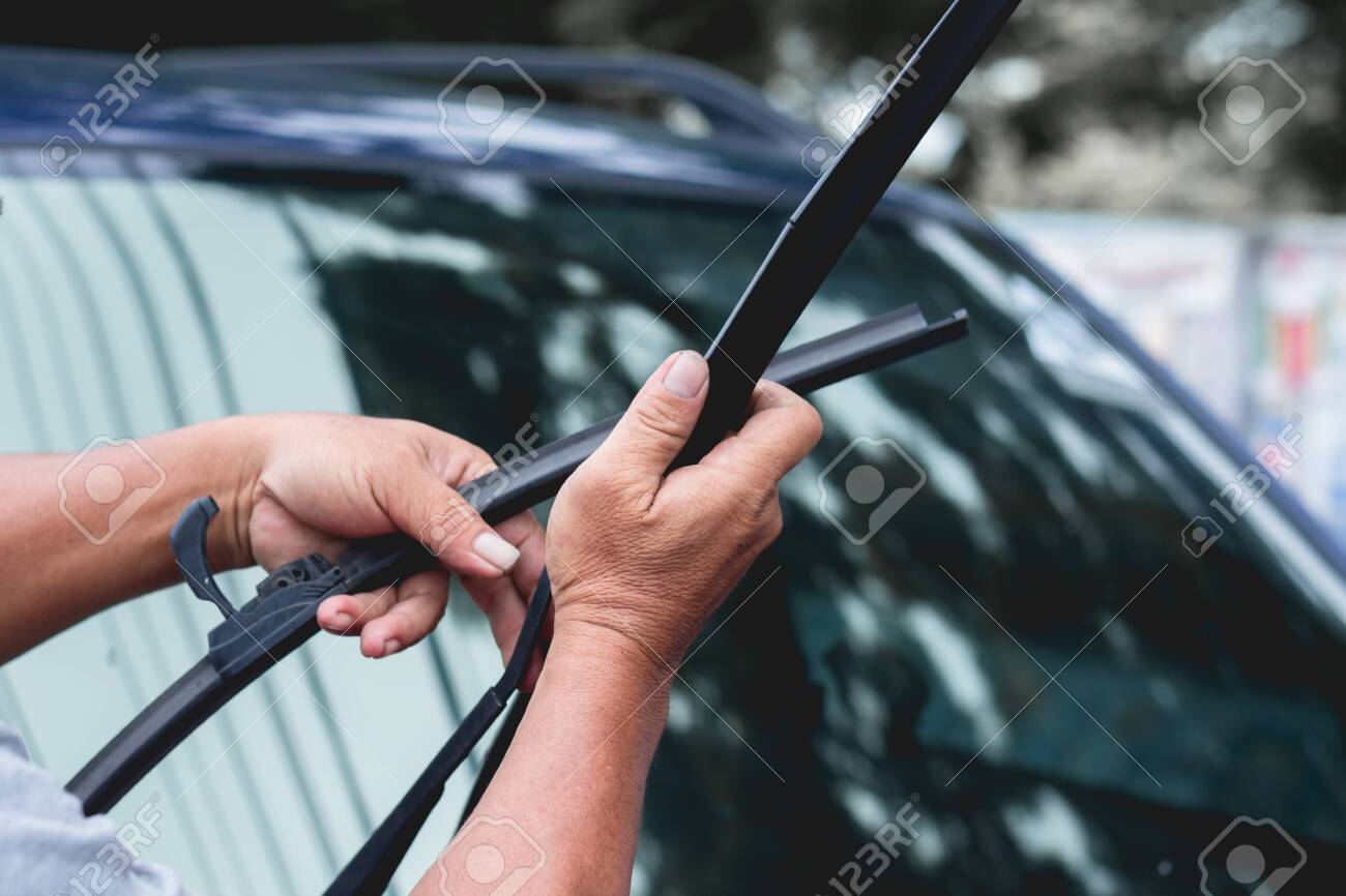 Mechanic Replace Windshield Wipers On Car Replacing Wiper Blades Change Stock Photo Picture And Royalty Free Image Image 144239764