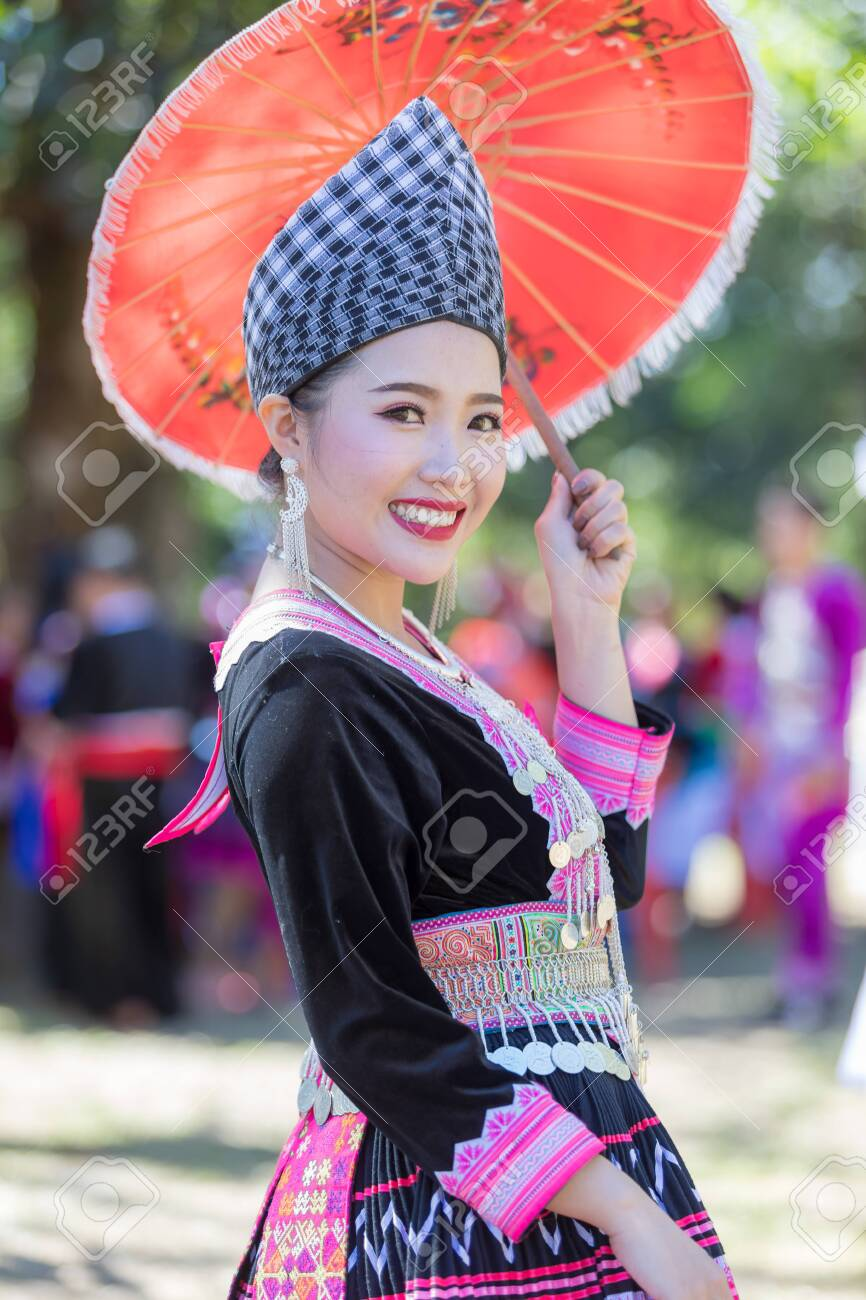Hmong girl in beautiful dress colorful and fashion mixed between