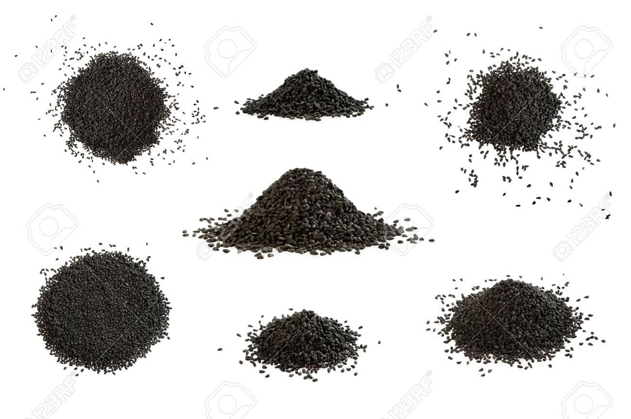 Big set of black cumin heap on white background. A pile of nigella sativa seed. - 121614433