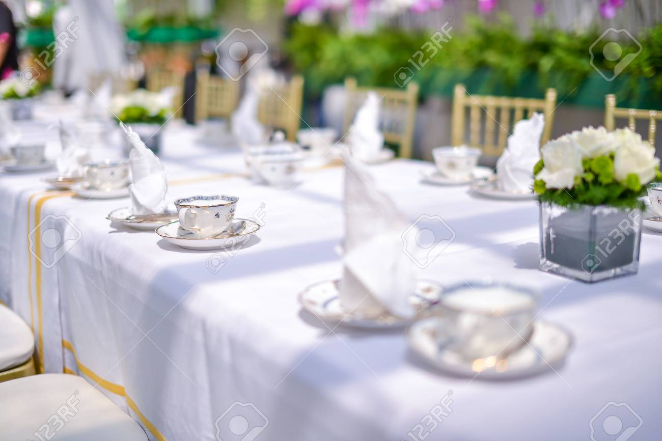 Vintage english style hi tea table decoration shallow dof with stock photo vintage english style hi tea table decoration shallow dof with selective focus on the cup junglespirit Image collections