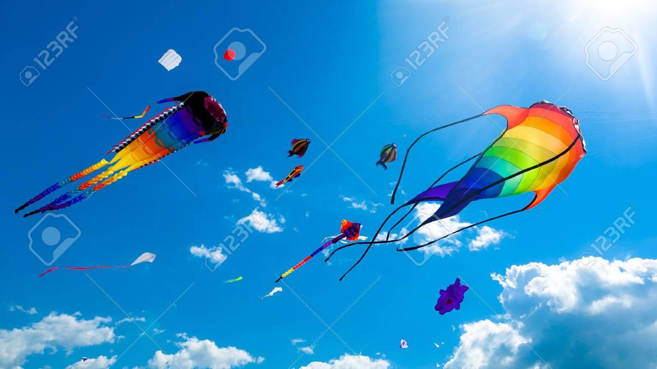 Various kites flying on the blue sky in the kite festival - 43612941