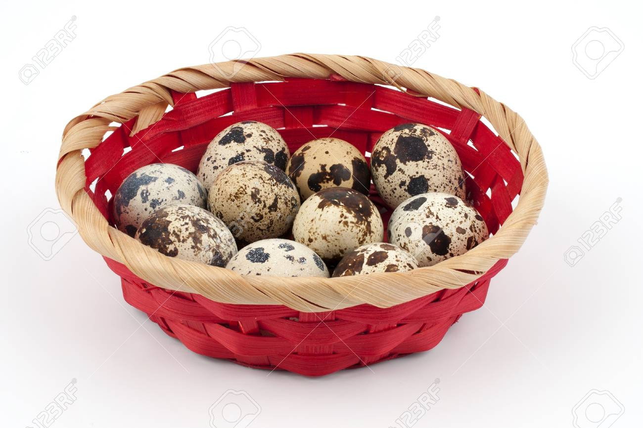 Quail eggs in a basket on a white background closeup Stock Photo - 16067462