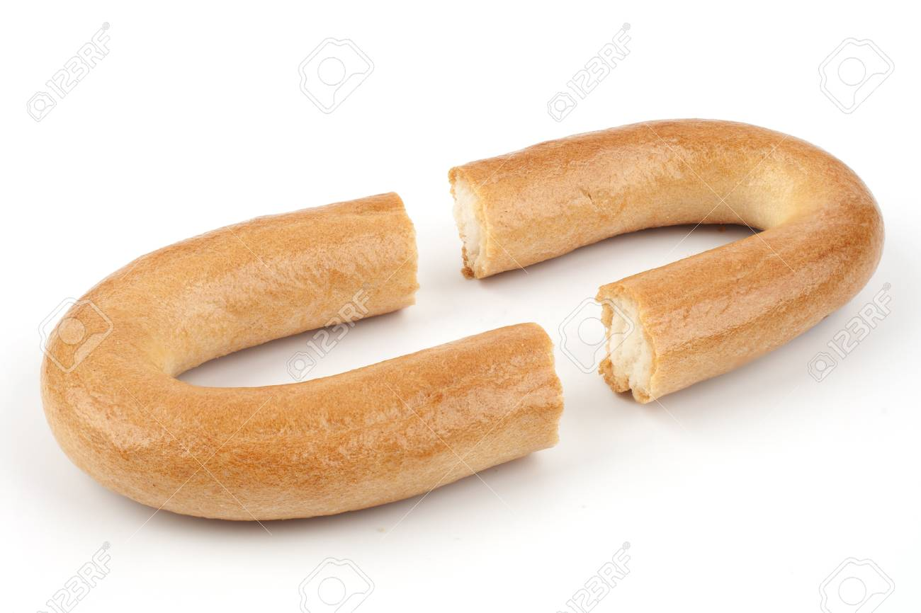One broken bagel on a white background Stock Photo - 17251734