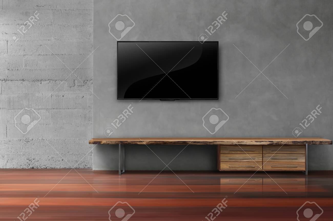 Led Tv On Concrete Wall With Wooden Furniture In Empty Living