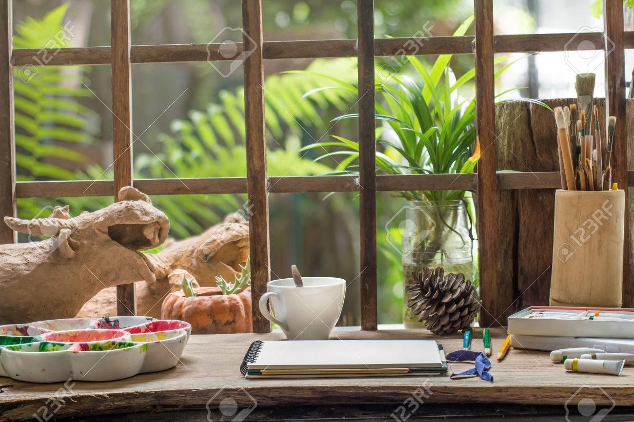 Sketch Book On Artist Work Desk With Small Garden Background