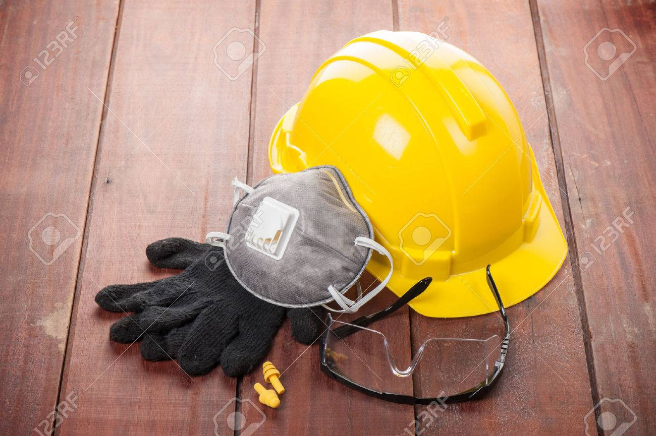 personal safety equipments on wooden plank - 38691396