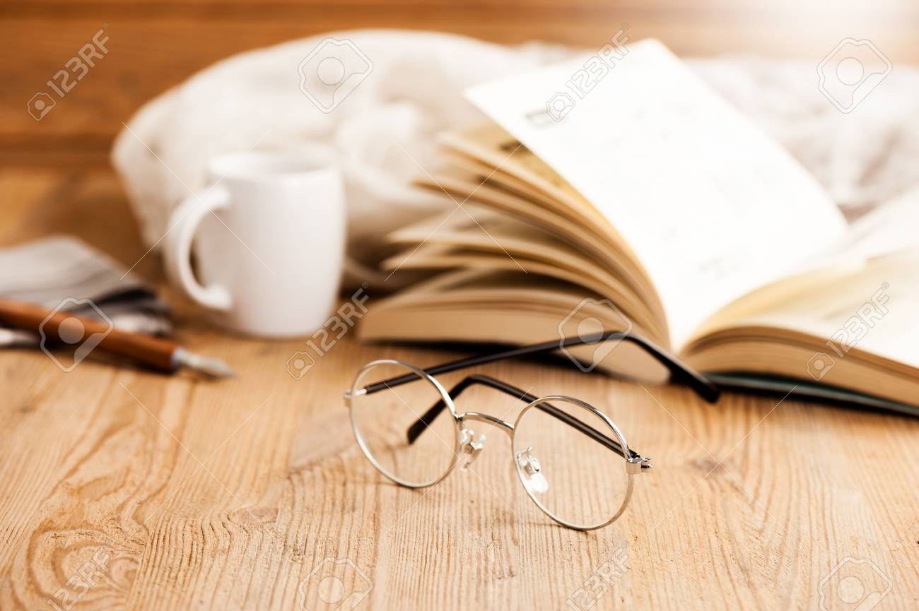 closeup round frame style of eyeglasses on wooden desk, shallow depth of field - 84249305