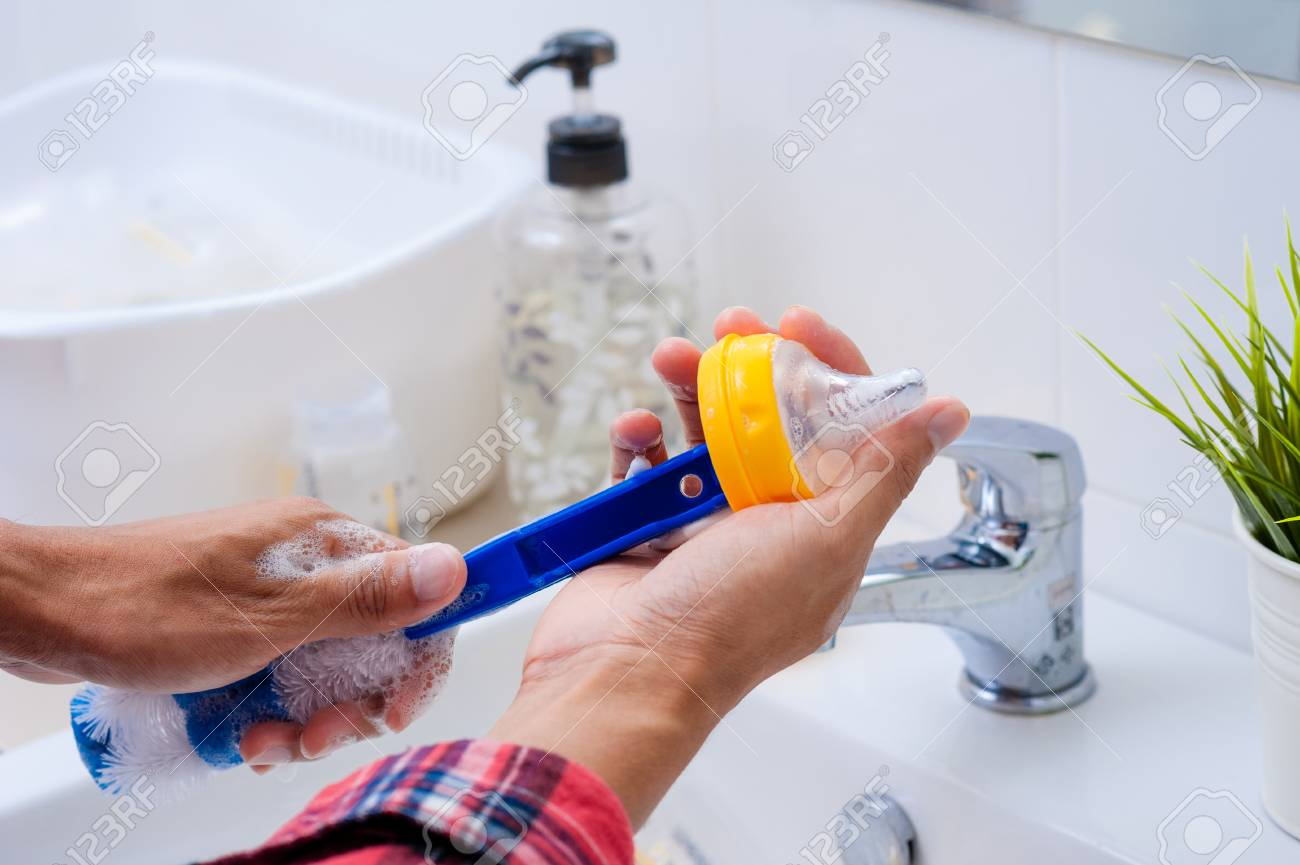 Washing Baby Bottles And Nipples With Soft Bottle Brush And ...
