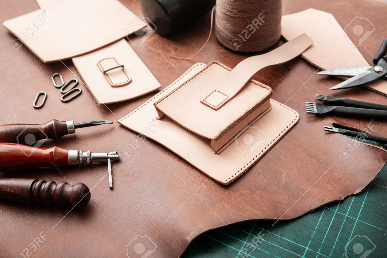 Making bag from vegetable tanned leather in workshop. - 163062129
