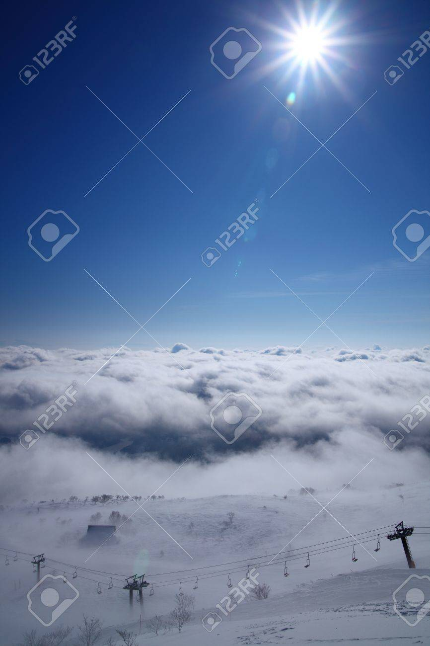 sea of clouds and sun, nagano japan, hakuba goryu ski resort stock