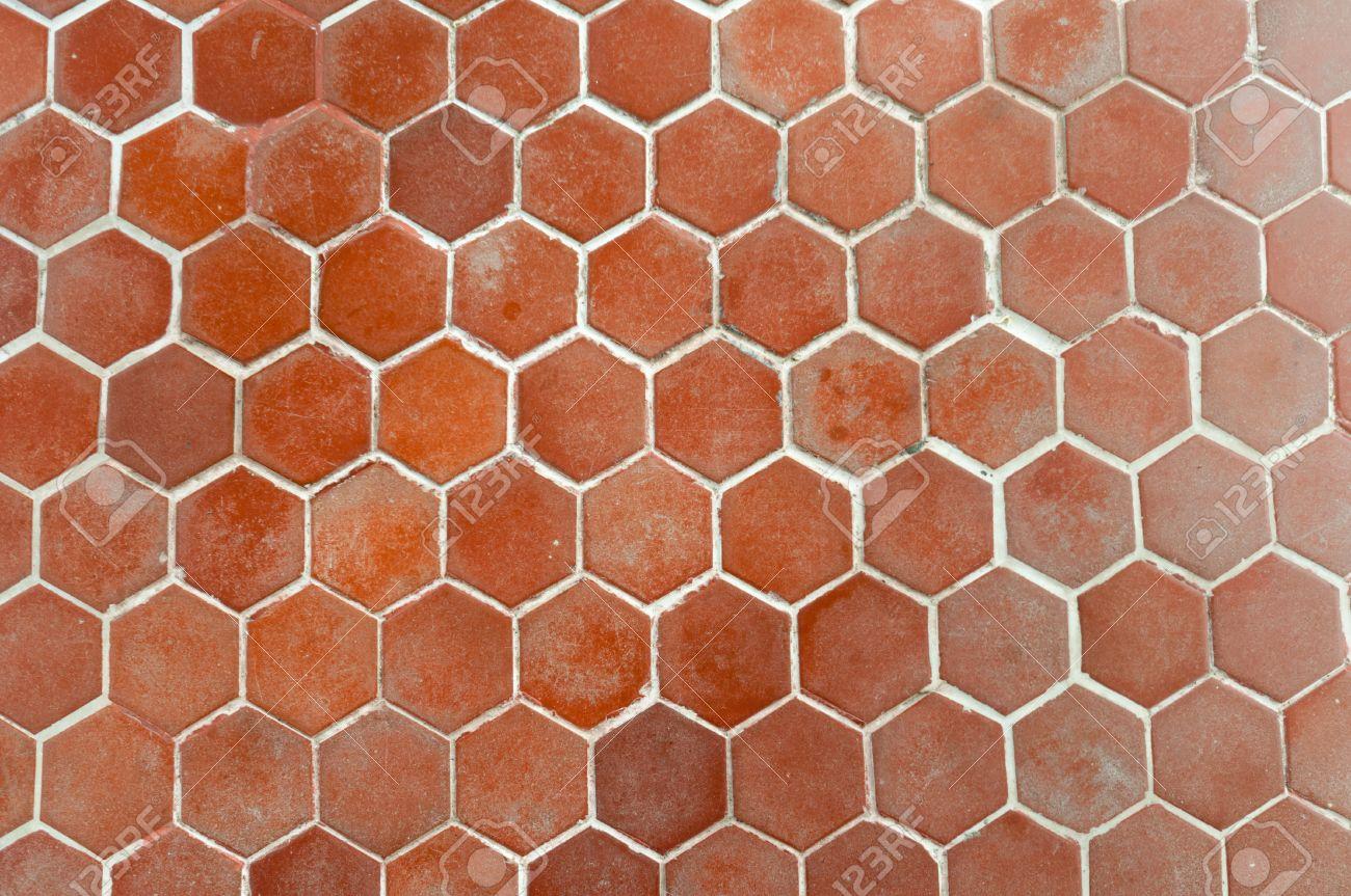 suelo de baldosas con el bloque hexagonal marrn foto de archivo