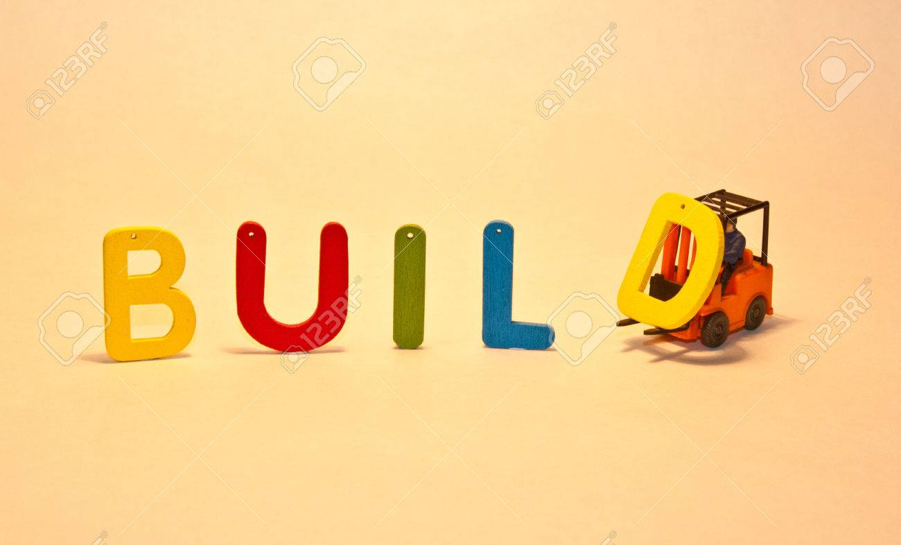 colorful wooden letters that spell the word build stock photo