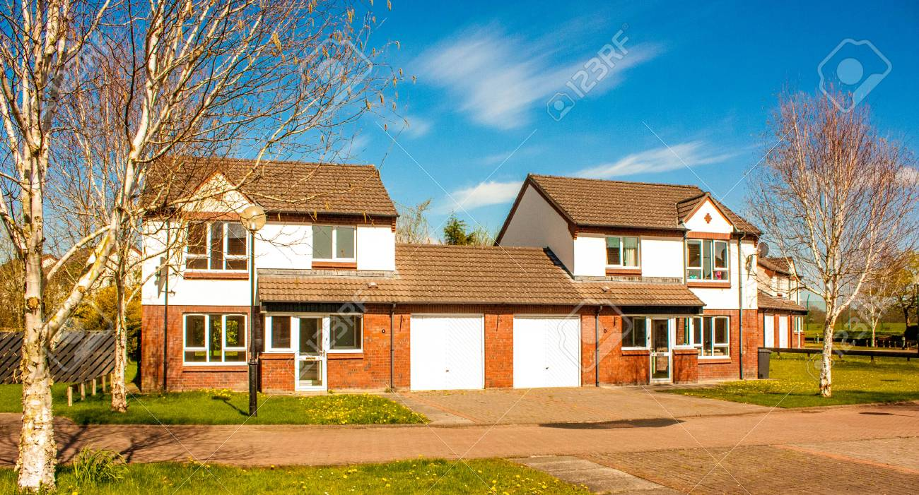 A typical British house, semi detatched with a garage and grass garden out front. - 89325957