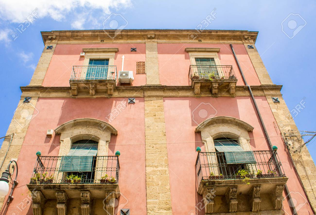 A view from the ground up of an old building in Sicily, Italy. - 104224104